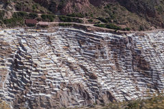 Salt evaporation ponds and mines built by Incas in Maras,  Peru Royalty Free Stock Photo