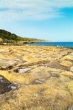 Salt evaporation ponds off the coast of Gozo,Malta Stock Photography