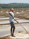 Salt salt extraction food industry India. Baths with salt, Man works salt extraction food industry India, Karnataka, Gokarna, March, 2017 royalty free stock image