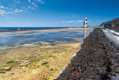 Salt extraction plant with lighthouse at salinas  La Palma Royalty Free Stock Image