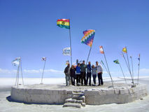 Salt flats Bolivia flags and people Royalty Free Stock Photo