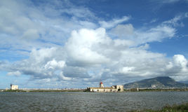 Salt flats and windmill. Mont Erice and salt flats - Trapani sicily Royalty Free Stock Photos
