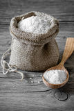 Salt. Food salt on a wooden surface stock images