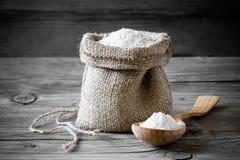 Salt. Food salt on a wooden surface stock images