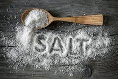 Salt. Food salt on a wooden surface royalty free stock images
