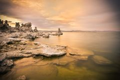 Salt formations at Mono Lake. The sun sets over the famous salt formations in Mono Lake California stock photos