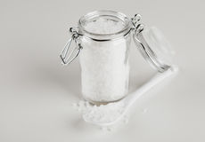 Salt in glass container Stock Photo