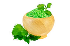 Salt in the green wood bowl with nettle Royalty Free Stock Photos