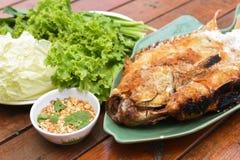 Salt-grilled fish. A Salt-grilled fish on table Stock Images