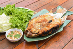 Salt-grilled fish. A Salt-grilled fish on table Royalty Free Stock Photos