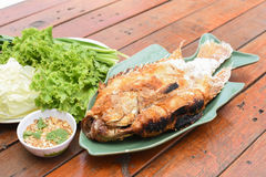 Salt-grilled fish. A Salt-grilled fish on table Royalty Free Stock Photo