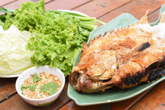 Salt-grilled fish. A Salt-grilled fish on table Stock Photos