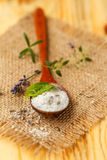 Salt and herbs. Healthy sea salt and herbs on wooden spoon closeup Stock Images
