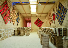 Salt Hotel in the Salt desert, Uyuni, Bolivia. Lobby of a hotel entirely made by salt, decorated with traditional carpets Stock Photos