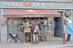 Salt House Bar, Galway, Ireland June 2017, Outside of the bar, a. Group of friends is having fun Stock Photography