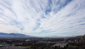 Salt Lake City and sky. The skyline of salt lake city is dwarfed by the sky and mountains in the background Stock Photo