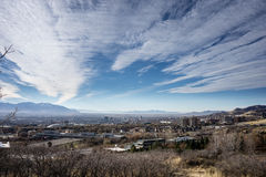 Salt Lake City and sky. The skyline of salt lake city is dwarfed by the sky and mountians in the background Royalty Free Stock Photography
