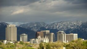 Salt Lake City Skyline with Storm Approaching. The image shows the downtown buildings and skyline, the historic Mormon temple, and the snow capped Wasatch Royalty Free Stock Photo