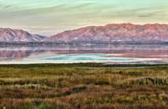 Salt Lake City - Sunset View of a Lake, Mountains and Meadows. Salt Lake City shot at sunset Stock Images