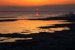 Salt lake Elton. salty water at sunrise Stock Image
