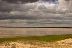 Salt Lake pink in the desert and cloudy sky Royalty Free Stock Images