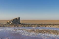 Salt lake in Sahara. Tunisia. Salt lake in Tunisia ,with big rock. Desert in Africa Royalty Free Stock Photo