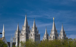 Salt Lake Temple. LDS Temple in Salt Lake City rising above tree branches Royalty Free Stock Photo