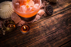 Salt lamp of pink Himalayan salt. On vintage wooden background Stock Photos