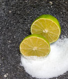 Salt and Lime in stone bowl Royalty Free Stock Photography