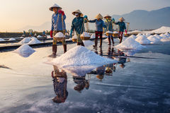 Salt makers. Hon Khoi field, Khanh Hoa, Vietnam - March 18, 2016 - Salt makers harvest salt in Hon Khoi fields Royalty Free Stock Images