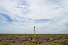 Salt marsh and lighthouse, Morro Jable, Fuerteventura Stock Photo