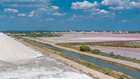 Salt marshes. Aigues-Mortes in France, Salins du Midi, panorama with salt marshes stock images