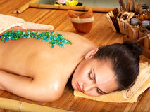 Salt massage. Young woman getting salt massage Royalty Free Stock Images