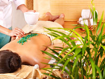 Salt massage in bamboo salon. Stock Images