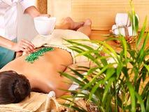 Salt massage in bamboo salon. Stock Images