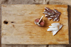 Salt meat and ingredients for cooking around cutting board on ru Royalty Free Stock Photos
