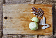 Salt meat and ingredients for cooking around cutting board on ru Stock Photos