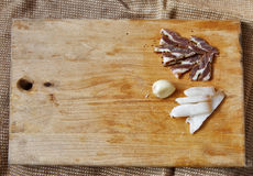 Salt meat and ingredients for cooking around cutting board on ru Stock Image