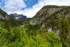 Salt mine in Hallstatt in Austria is surrounded by mountains and beautiful and colorful trees in summer. Stock Image