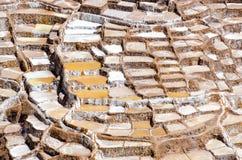 Salt mine. Of Maras near the city of Cusco in Peru stock photos