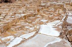 Salt mine. Of Maras near the city of Cusco in Peru stock images
