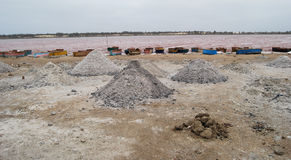 Salt mounds at Lac Rose, Senegal. Mounds of drying salt border the edge of the famous pink waters of Lac Rose in Senegal, West Africa, the source of most of the Stock Photo