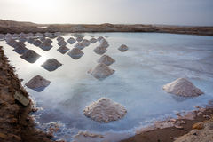 Salt mounds in a salt pond Royalty Free Stock Photos