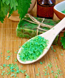 Salt with nettles in mortar on board Stock Photos