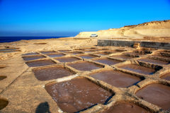 Salt panes on Gozo island. Manmade salt pools on a Gozo coastline Royalty Free Stock Photography