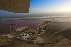 Salt pans. Sight seeing flight going North of Swakopmund along the Skeleton Coast Namibia Royalty Free Stock Photos