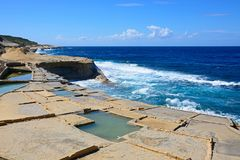 Salt pans and sea view, Marsalforn. Salt pans along the waterfront with views out to sea, Redoubt, Marsalforn, Gozo, Malta, Europe Stock Photos