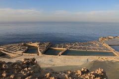 Salt pans. Salt evaporation ponds (salt pans) located near Qbajjar on the maltese Island of Gozo royalty free stock image