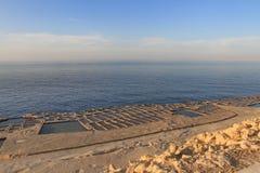 Salt pans. Salt evaporation ponds (salt pans) located near Qbajjar on the maltese Island of Gozo royalty free stock photography