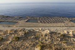 Salt pans. Salt evaporation ponds (salt pans) located near Qbajjar on the maltese Island of Gozo stock image